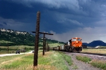 A coal train holds on the main while a massive storm rolls in